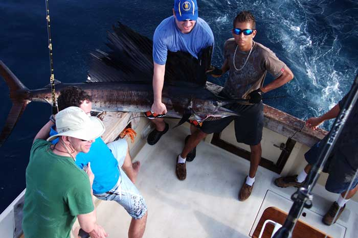 Clients of Alpha Mike with Sailfish in Costa Rica